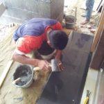 Pemasangan keramik Granito di teras depan rumah bintaro